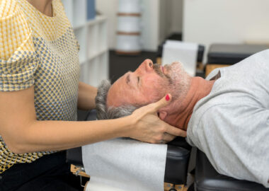 Man having chiropractic back adjustment. Physioterapy, osteopathy, alternative medicine pain relief rehabilitation